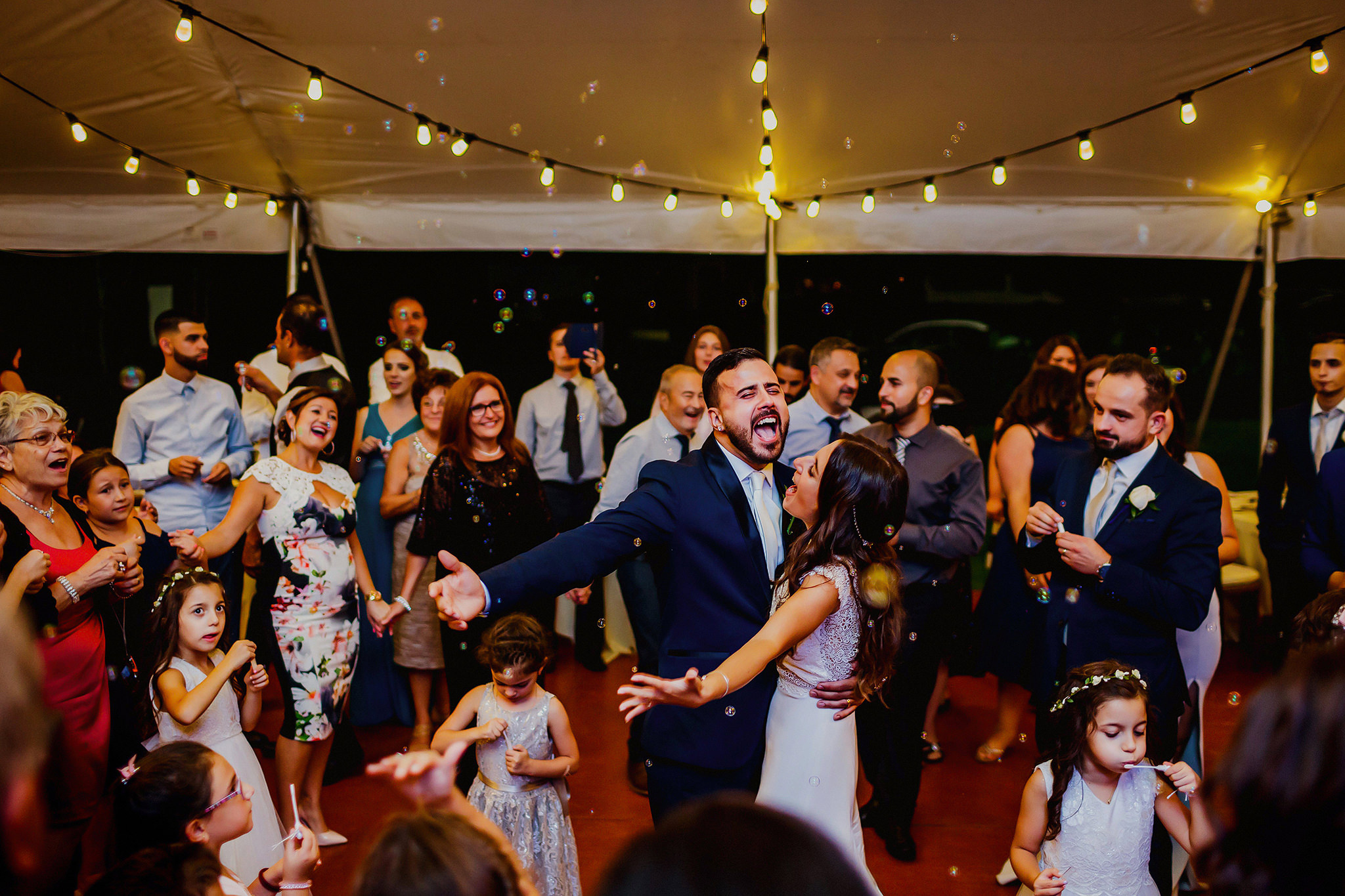 bride & groom celebrate with guests at Montreal wedding