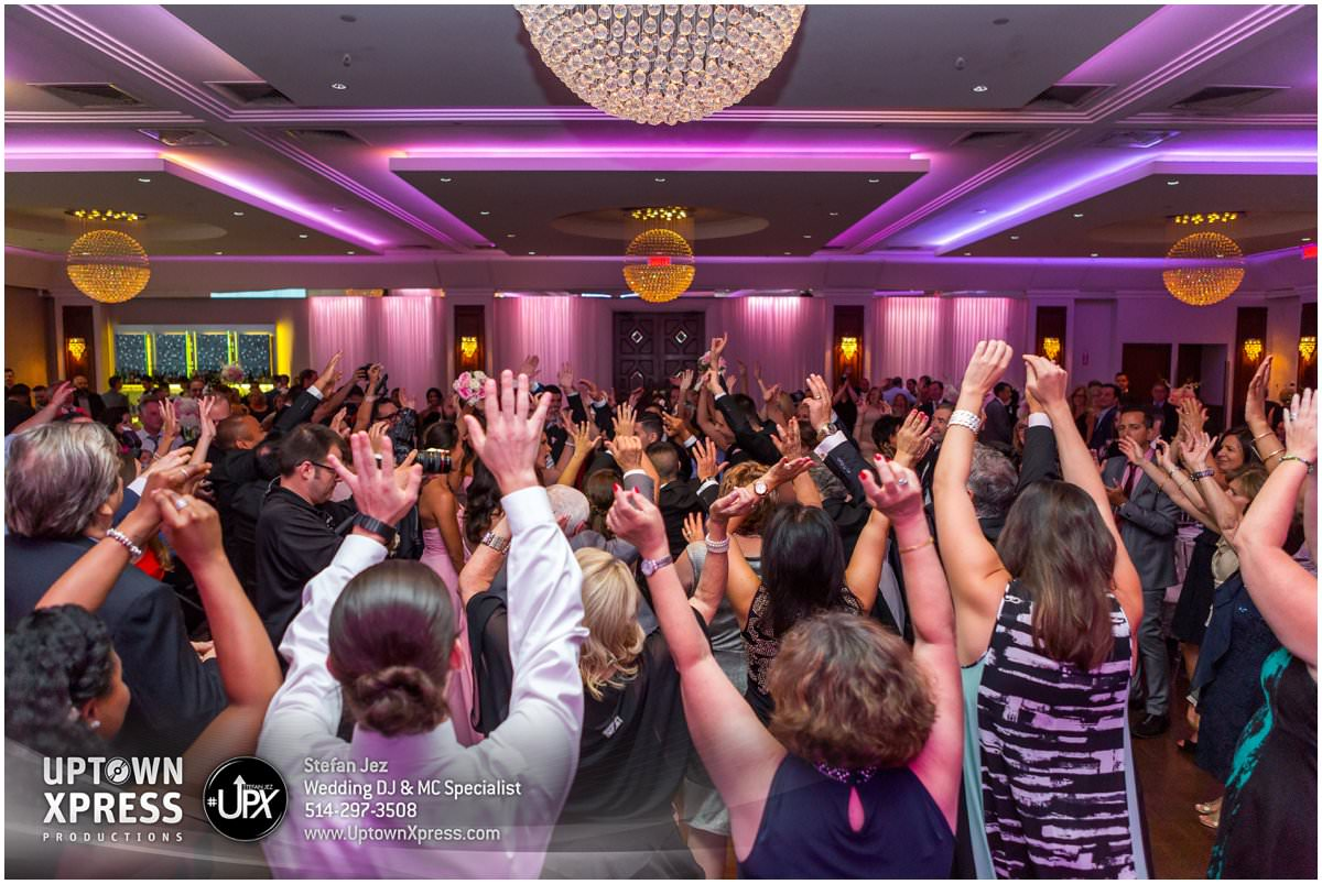 A wedding DJ entertains a packed dancefloor in Montreal